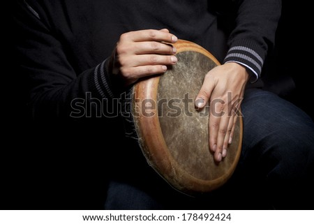 man beating tomtom - stock photo