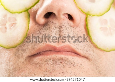 Man beauty care with cucumber