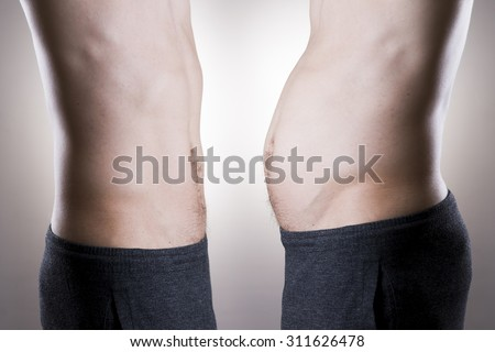 Man before and after weight loss. Fat and slim body on a gray background - stock photo