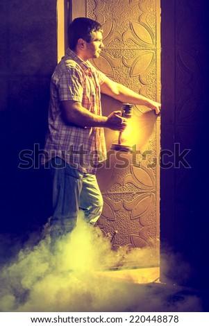 man before doorway of light - stock photo