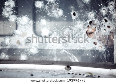 Man behind broken glass of the car - stock photo