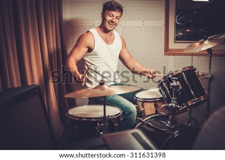Man behind drums on a rehearsal  - stock photo