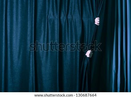 man behind the dark curtain. - stock photo