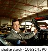 Man behind wheel in a retro car - stock photo