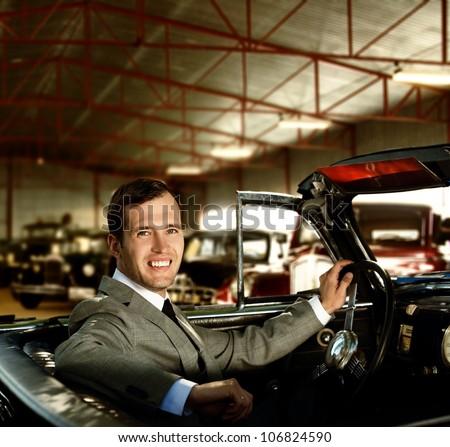 Man behind wheel in a retro car - stock photo