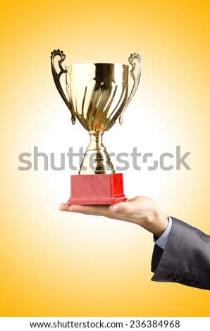 Man being awarded with golden cup - stock photo