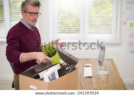 Man being fired from his job - stock photo