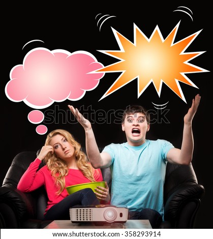 Man being really expressive about the football match while his wife finds it boring. Comics concept. - stock photo