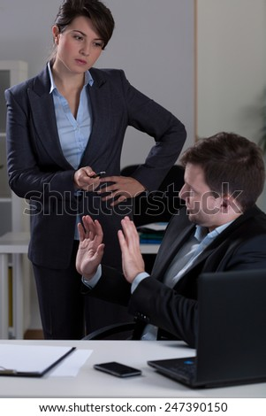 Man being victim of mobbing in corporation - stock photo