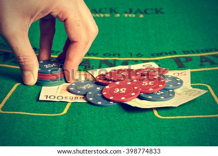 Man betting with poker chips. Horizontal image. Vintage style.