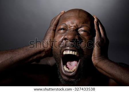 Man Blocking Out Loud Noises - stock photo