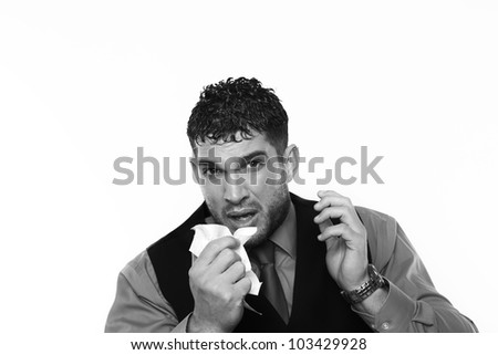 man blowing his nose will a bad cold