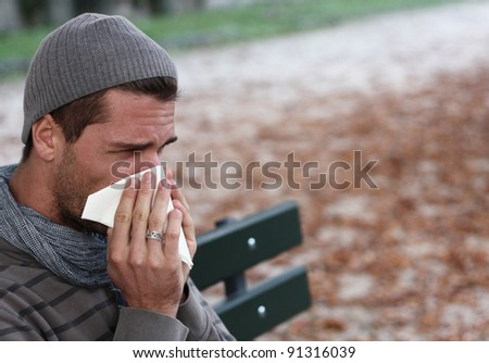 man blowing nose - stock photo