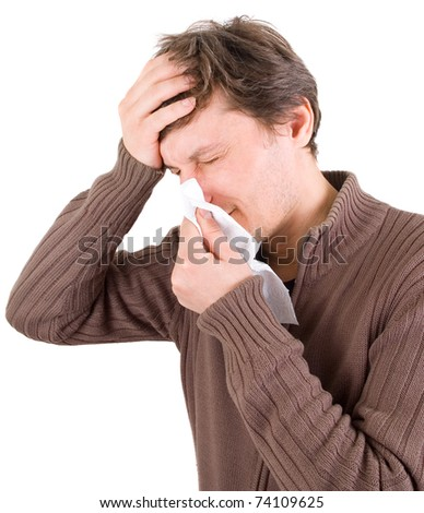 man blowing nose with handkerchief - stock photo