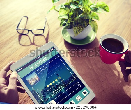 Man Booking Hotel Reservation on Digital Tablet - stock photo