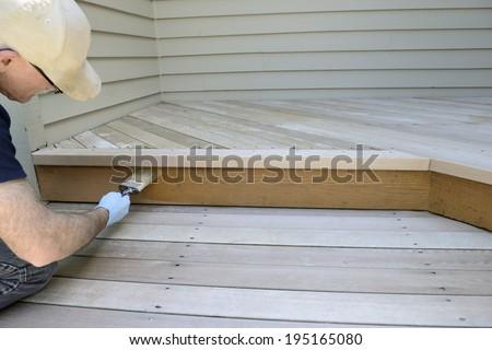 Man Brushing on Stain - stock photo