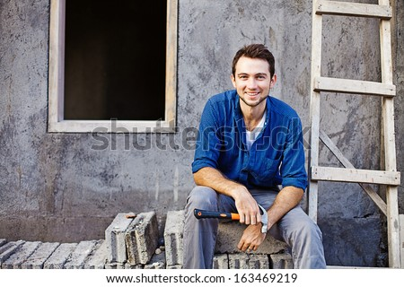 man building or repairing his house