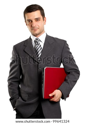 man businessman in suit with laptop in his hands, looking on camera - stock photo