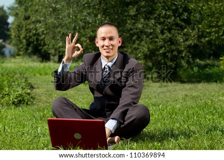 Man Businessman working outdoors, as freelanser and have fun