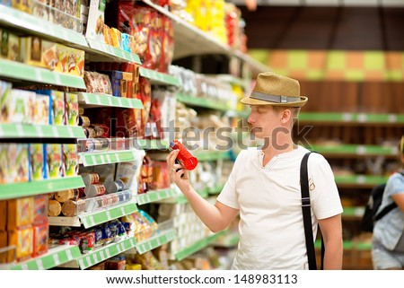 man buys  products at the supermarket