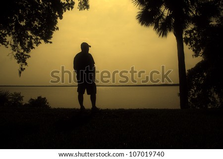 Man by the Waterfront Silhouette - stock photo