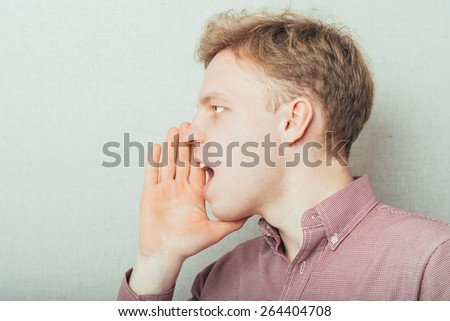 Man calling, Shouting  with hands near his mouth - stock photo