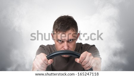 Man car driver with the wheel in the smoke, auto concept - stock photo