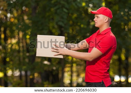 man carries a box - stock photo