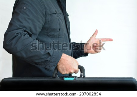 Man carry travel suitcase against white background with copy space. Concept photo of travel, vacation, holiday, destination, tourism, traveler, tourist. - stock photo