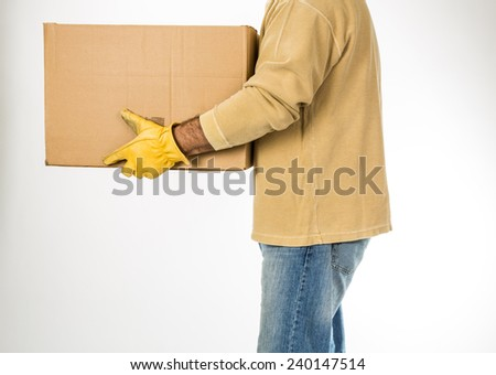 Man carrying a box in work clothing and gloves on a white background. - stock photo