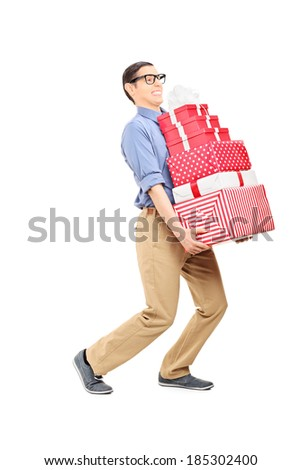 Man carrying a heavy load of presents isolated on white background