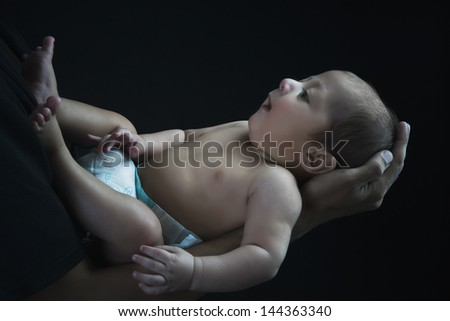 Man carrying his son in arms