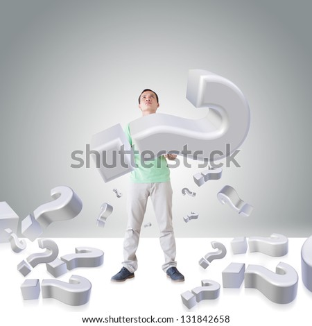 Man Carrying Question Mark - stock photo