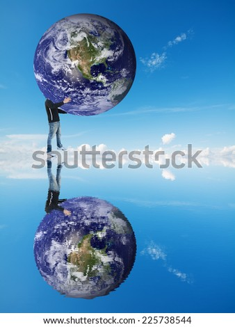 man carrying the earth over the water. Elements of this image furnished by NASA