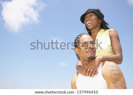 Man carrying woman on his back