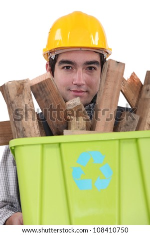 Man carrying wood to be recycled - stock photo
