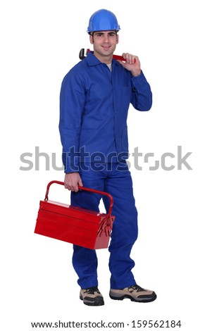 Man carrying wrench and tool-box - stock photo