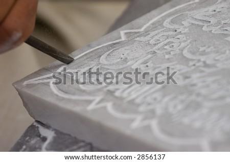 man carving - stock photo