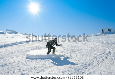 Man carving on snow - stock photo