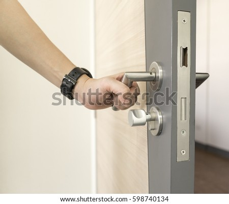 man catch Door Handles stainless steel on door wood to open & Man Hand Open Door Knob Stock Photo 133893713 - Shutterstock Pezcame.Com