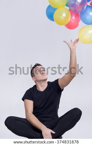 Man catching balloons
