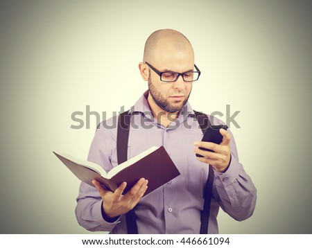 man caucasian professor in a lavender shirt with a beard reading old book isolated studio  background    - stock photo