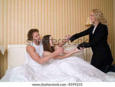 Man caught with his mistress by his girlfriend - stock photo