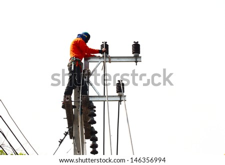 Man changing electric cable line with safety gears - stock photo