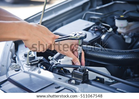 Man check and repair the car engine.