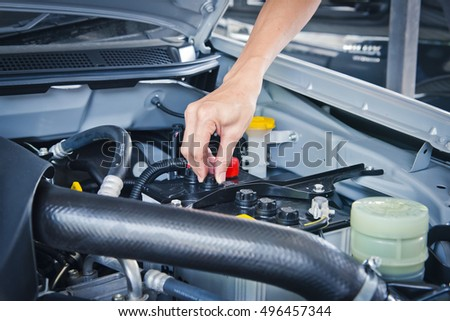 Man check the car engine, Check the condition of the car engine.