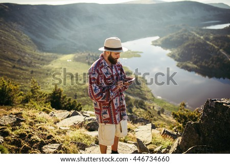 Man checking his phone in nature