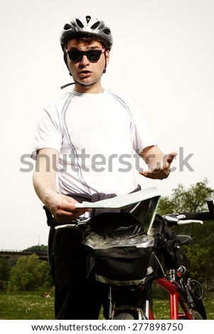 Man checking his way with map - stock photo
