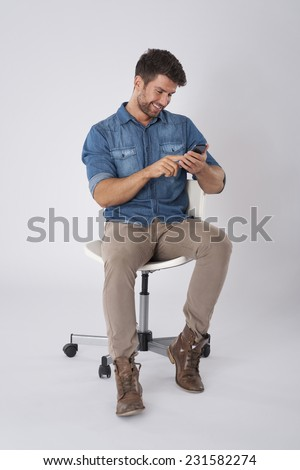 Man checking something on mobile phone - stock photo