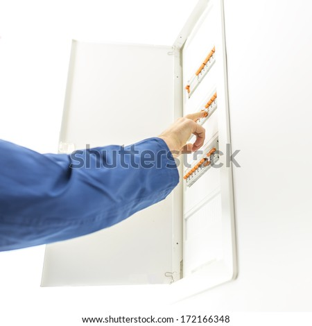 stock photo man checking the electrical fuse box at his house to see if any of the circuit breakers have tripped 172166348 electrical breaker stock images, royalty free images & vectors checking fuses in breaker box at n-0.co